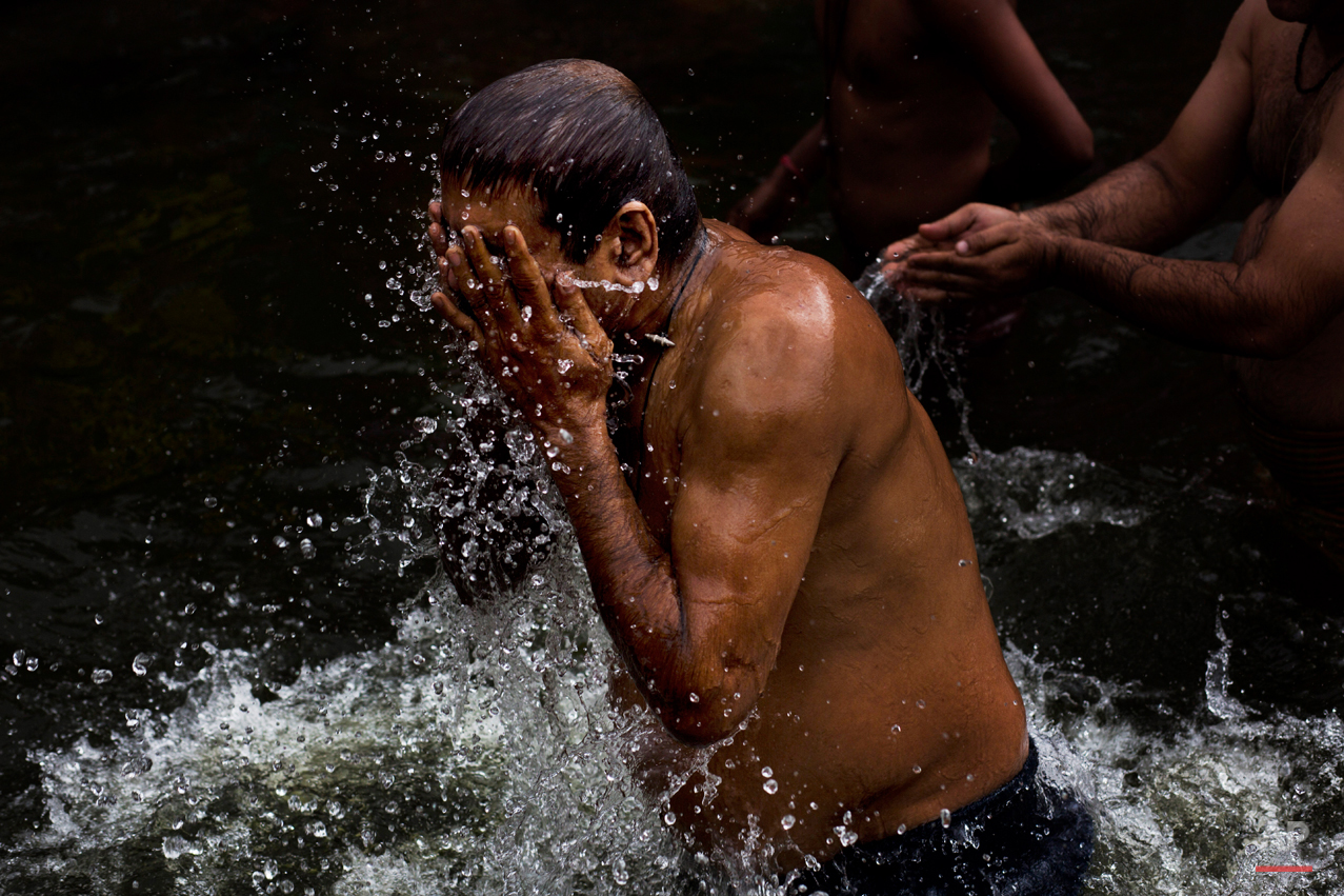 In this Wednesday, Aug. 26, 2015, photo, Hindu devotees perform a holy dip in the Godavari River during Kumbh Mela, or Pitcher Festival, in Nasik, India. Millions of Hindus are expected to immerse themselves in the Godavari River as a way to cleanse themselves of sin and come closer to God at this year's Kumbh Mela festival. (AP Photo/Bernat Armangue)