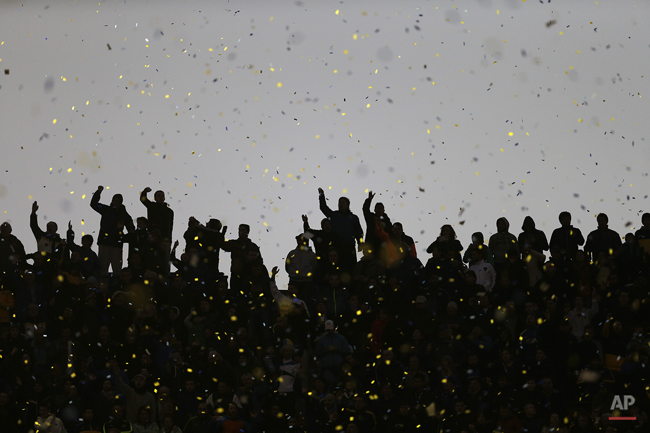 Boca Juniors fans cheer for their team during a local tournament soccer match against River Plate in Buenos Aires, Argentina, Sunday, May 3, 2015. (AP Photo/Natacha Pisarenko)