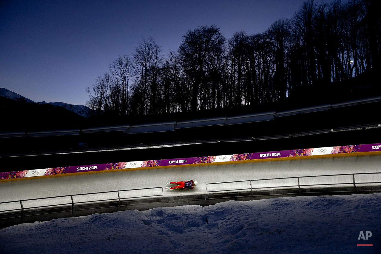 Lien Te-An of Taiwan takes a turn during a training session for the men's singles luge at the 2014 Winter Olympics, Friday, Feb. 7, 2014, in Krasnaya Polyana, Russia. (AP Photo/Natacha Pisarenko)