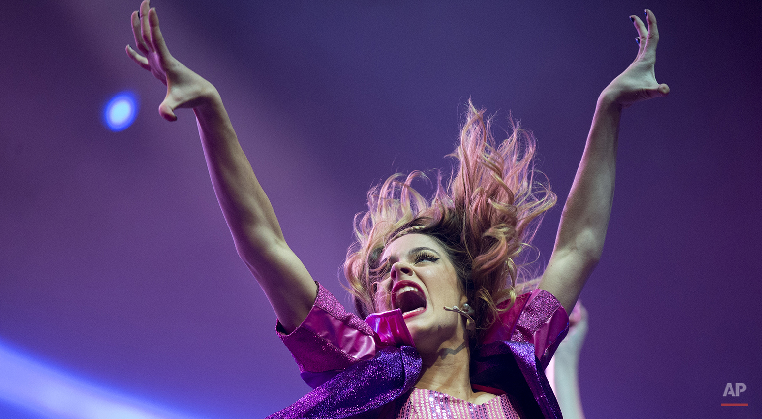 """Disney Channel star Martina Stoessel, of Argentina, performs in concert as """"Violetta,"""" her character from the Disney Channel television series of the same name, in Buenos Aires, Argentina, Tuesday, July 23, 2013. (AP Photo/Natacha Pisarenko)"""