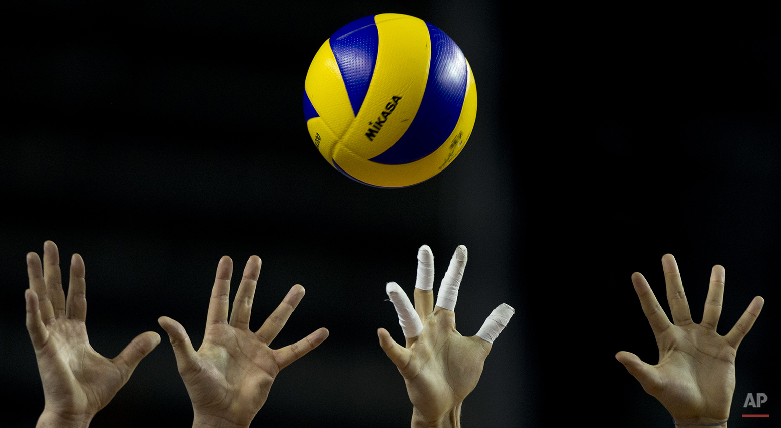 Bulgaria's players try to stop a spike from Brazil during a 2013 Volleyball World League semifinal match in Mar del Plata, Argentina, Saturday, July 20, 2013. Brazil won 3-1. (AP Photo/Natacha Pisarenko)