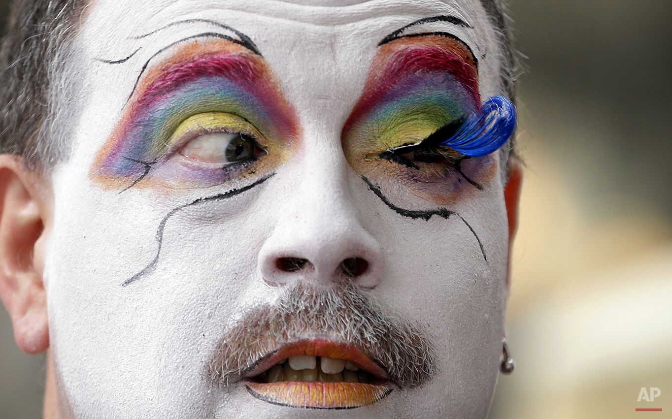 Brian Lavalle, also known as Sister Bebe Jeebus, a member of the Sisters of Perpetual Indulgence, looks across at his newly-applied eyelash as he prepares for the 41st annual Pride Parade Sunday, June 28, 2015, in Seattle. (AP Photo/Elaine Thompson)