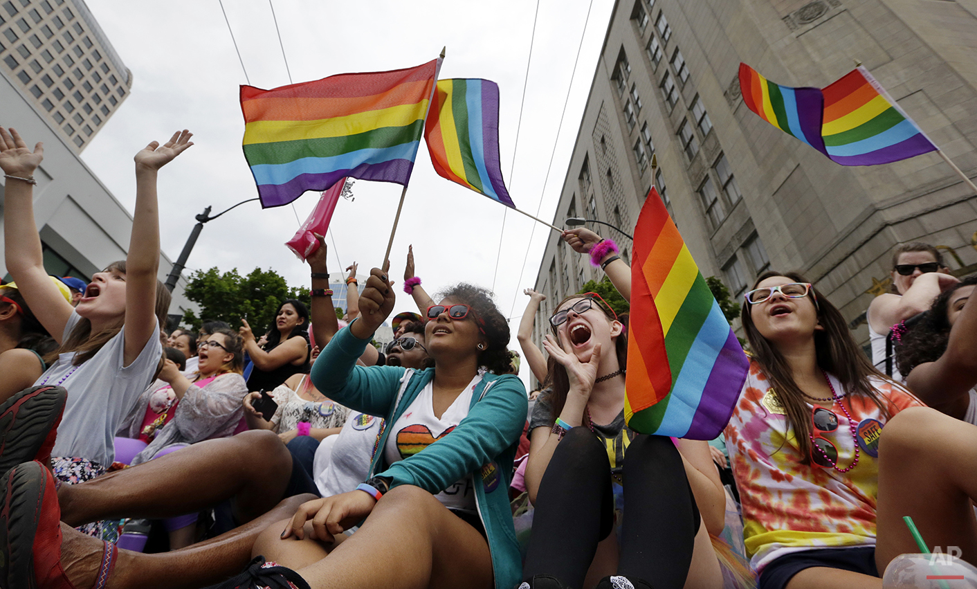 Parade viewers cheer at the 41st annual Pride Parade Sunday, June 28, 2015, in Seattle. Rainbows and good cheer were out in force Sunday as hundreds of thousands of people packed gay pride events from New York City to Seattle, San Francisco to Chicago to celebrate a Supreme Court ruling legalizing same-sex marriage. (AP Photo/Elaine Thompson)