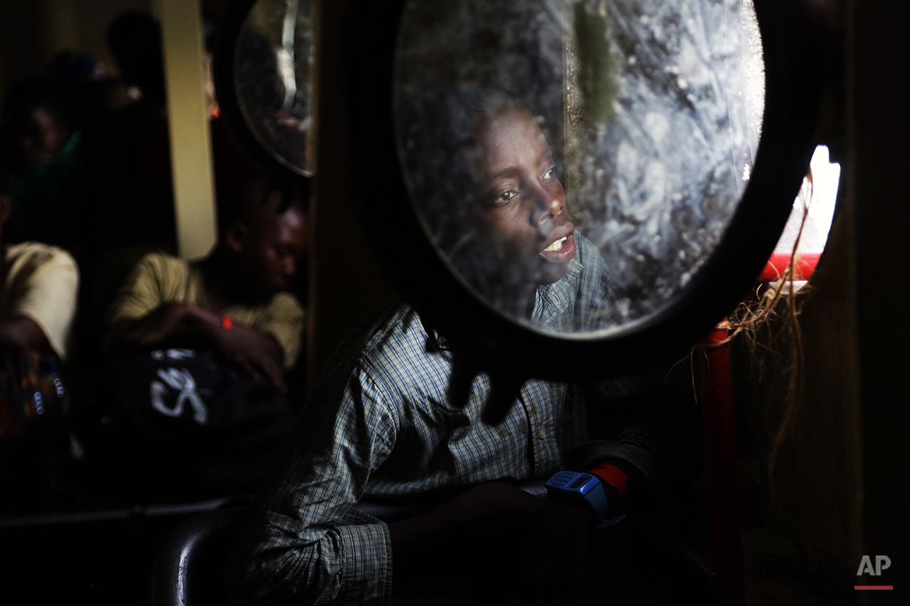 A young refugee who fled Burundi's violence and political tension looks at the shore line as he makes the journey on Lake Tanganyika, ,Tanzania from Kagunga to the port city of Kigoma in a ship freighted by the UN  Saturday May 23, 2015. An outbreak of cholera has infected 3,000 people in a Tanzanian border region where refugees fleeing political unrest in Burundi have massed, the U.N. Refugee Agency said Friday, May 22, 2015. Some 300 to 400 new cases of cholera are being reported daily. At least 31 people — 29 refugees and two Tanzanians — already have died of the disease, according to UNHCR. More than 64,000 Burundians have fled to Tanzania in recent weeks, UNHCR said, escaping the unrest sparked by their president's bid for a third term that many say is unconstitutional. (AP Photo/Jerome Delay)