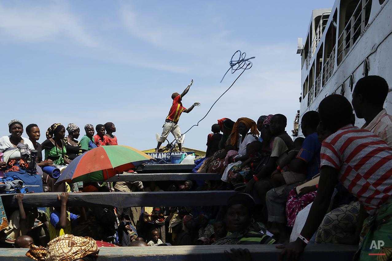 Refugees who fled Burundi's violence and political tension reach a ship freighted by the UN, at Kagunga on Lake Tanganyika, Tanzania, Saturday, May 23, 2015 to be taken to the port city of Kigoma. An outbreak of cholera has infected 3,000 people in a Tanzanian border region where refugees fleeing political unrest in Burundi have massed, the U.N. Refugee Agency said Friday, May 22, 2015. Some 300 to 400 new cases of cholera are being reported daily. At least 31 people — 29 refugees and two Tanzanians — already have died of the disease, according to UNHCR. More than 64,000 Burundians have fled to Tanzania in recent weeks, UNHCR said, escaping the unrest sparked by their president's bid for a third term that many say is unconstitutional. (AP Photo/Jerome Delay)