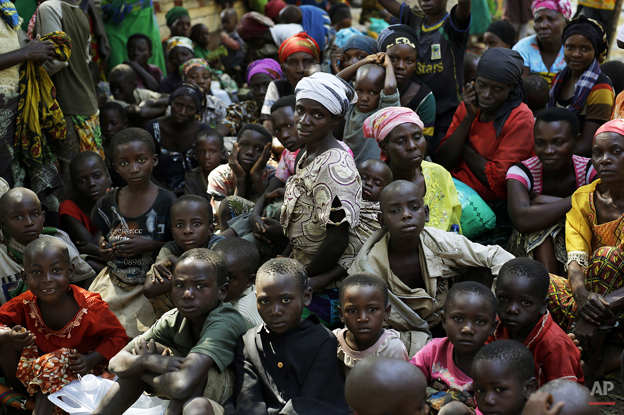 Europe And Africa Week In Pictures - FILE - In this file photo dated Saturday, May 23, 2015, refugees who fled Burundi's violence and political tension wait to board a UN ship, at Kagunga on Lake Tanganyika, Tanzania, to be taken to the port city of Kigoma. An outbreak of cholera has infected 3,000 people in a Tanzanian border region where refugees fleeing political unrest in Burundi have massed, the U.N. Refugee Agency said Friday, May 22, 2015, with hundreds more cases being reported daily. (AP Photo/Jerome Delay, FILE)