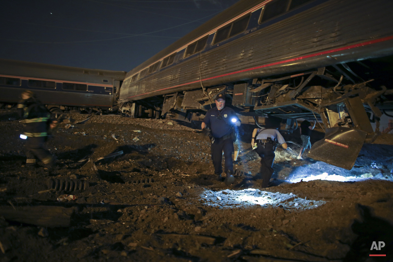Emergency personnel work the scene of a deadly Amtrak train wreck, Tuesday, May 12, 2015, in Philadelphia. (AP Photo/ Joseph Kaczmarek)