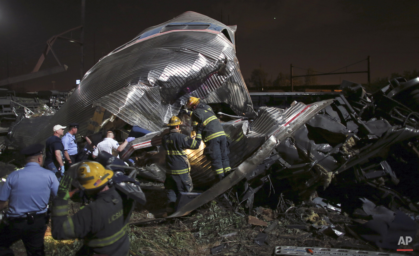 Emergency personnel work the scene of a Amtrak train wreck, Tuesday, May 12, 2015, in Philadelphia. (AP Photo/Joseph Kaczmarek)