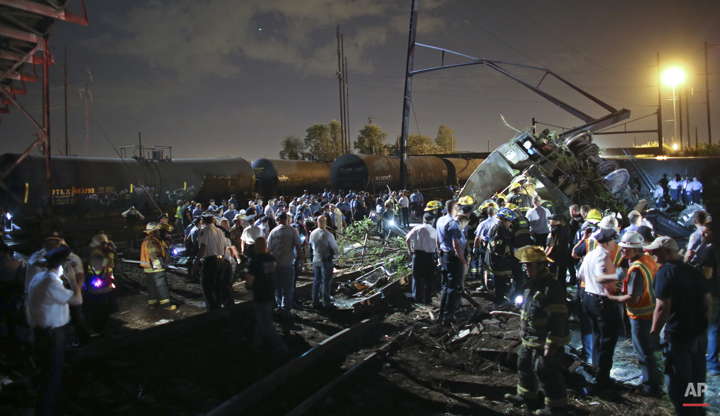 Emergency personnel work the scene of a Amtrak train wreck, Tuesday, May 12, 2015, in Philadelphia.  (AP Photo/ Joseph Kaczmarek)