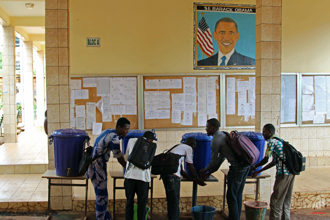 In this photo taken on Saturday, June 13, 2015, students at the Obama University wash their hands in Conakry, Guinea. Barack Obama, the United Statesí first African-American president, has captured the imagination of people across the continent where his face shows up on billboards, backpacks, T-shirts and restaurants.  On Friday, July 24, 2015 Obama will be visiting Kenya, where his father was born, for a summit on entrepreneurship before heading to Ethiopia to address leaders at the African Union headquarters. Wherever he goes, large crowds are expected to gather and cheer him.(AP Photo/Youssouf Bah)