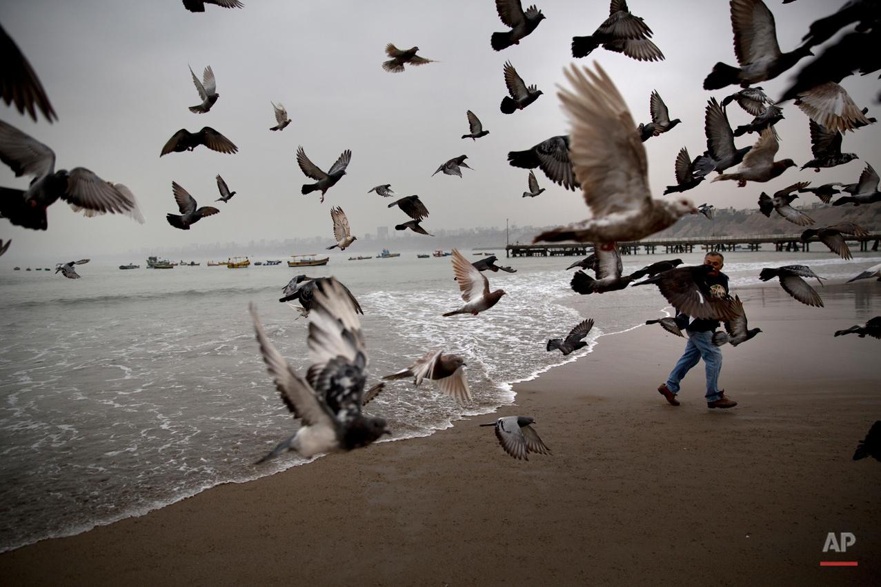 APTOPIX Peru Sea Therapy Photo Essay
