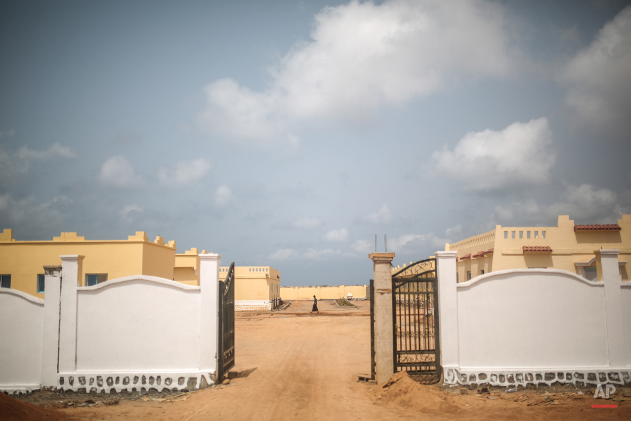 In this Wednesday, May 20, 2015 photo, a Yemeni refugee walks at an orphanage that has been turned into a center for Yemeni refugees, in Obock, northern Djibouti. The UNHCR says a total of 5,000 Yemeni refugees have made it to Djibouti, including 3,000 in the capital, Djibouti city, and 1,000 in Obock, 300 kilometers (187 miles) to the north making it currently the biggest Yemeni refugee population. (AP Photo/Mosa'ab Elshamy)