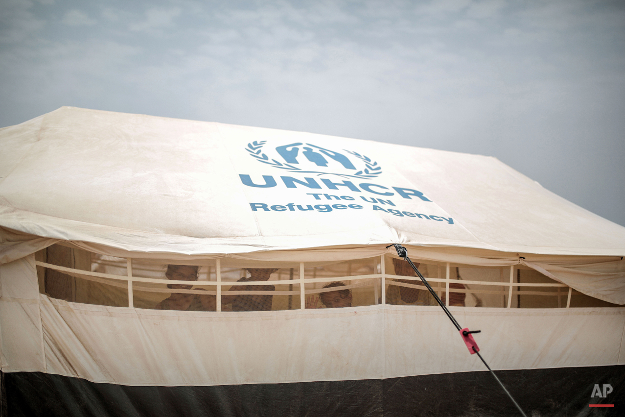 In this Tuesday, May 19, 2015 photo, Yemeni refugee children pose for a photo inside their family tent at the Markaze refugee camp in Obock, Djibouti. Fleeing the war at home, thousands of Yemenis have made it across the Gulf of Aden to find refuge in Djibouti, a sleepy Horn of Africa nation where the United Nations has set up a staging hub for aid for the conflict-torn Arab country. (AP Photo/Mosa'ab Elshamy)