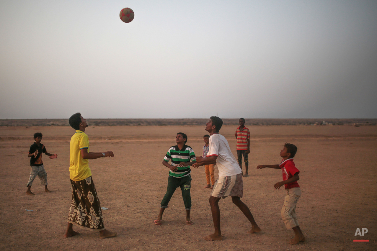 In this Wednesday, May 20, 2015 photo, Yemeni refugees play football outside the Markaze refugee camp where Yemeni refugees are stationed, in Obock, northern Djibouti. Many of the refugees are relieved to have escaped after two months of Saudi-led airstrikes targeting Yemenís Shiite rebels and fighting on the ground between rival factions that have pushed their country to the brink of collapse. (AP Photo/Mosa'ab Elshamy)