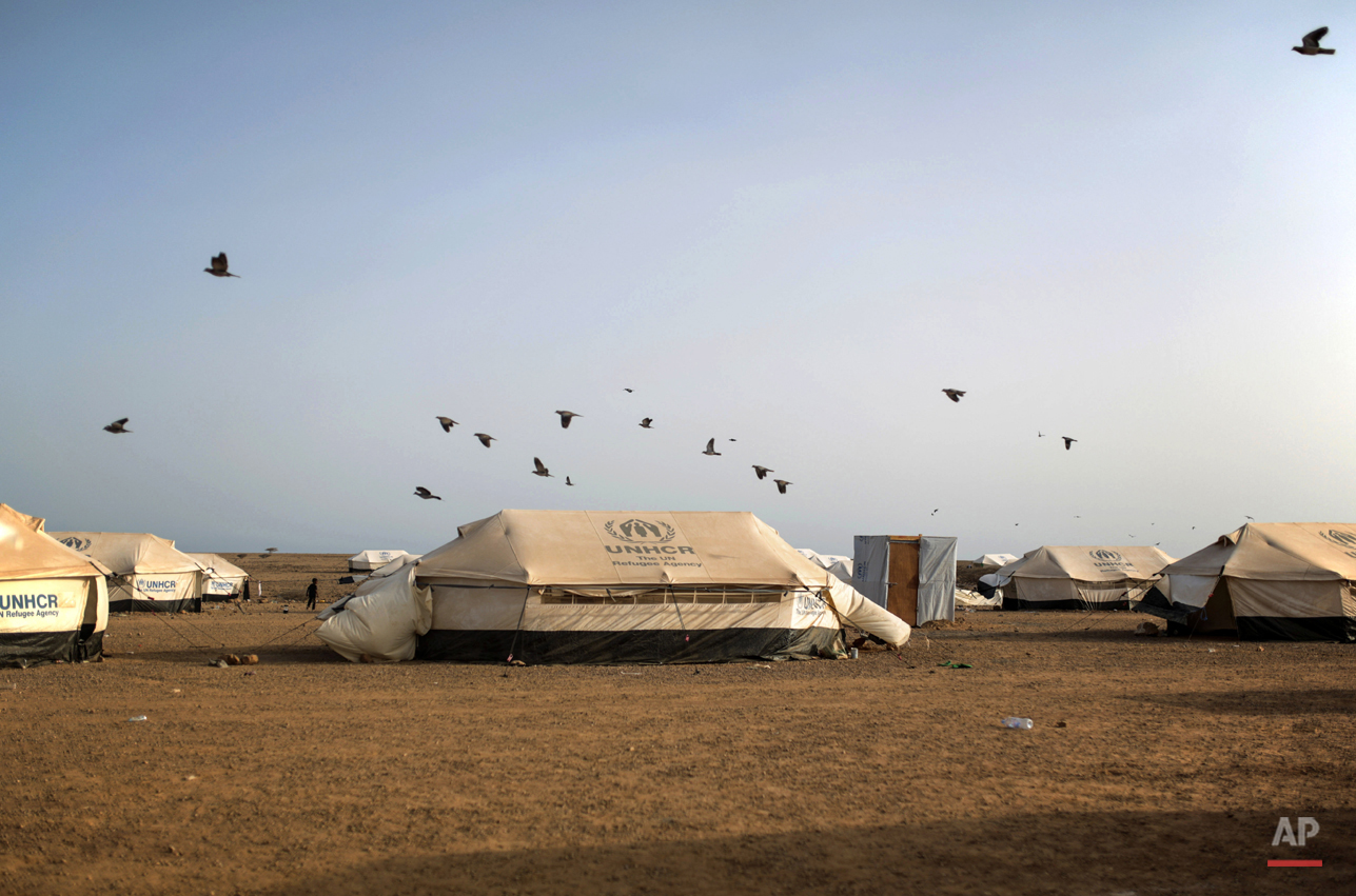 In this Tuesday, May 19, 2015 photo, pigeons fly over the Markaze refugee camp where Yemeni refugees are stationed in Obock, Djibouti. Many of the refugees are relieved to have escaped after two months of Saudi-led airstrikes targeting Yemenís Shiite rebels and fighting on the ground between rival factions that have pushed their country to the brink of collapse. (AP Photo/Mosa'ab Elshamy)