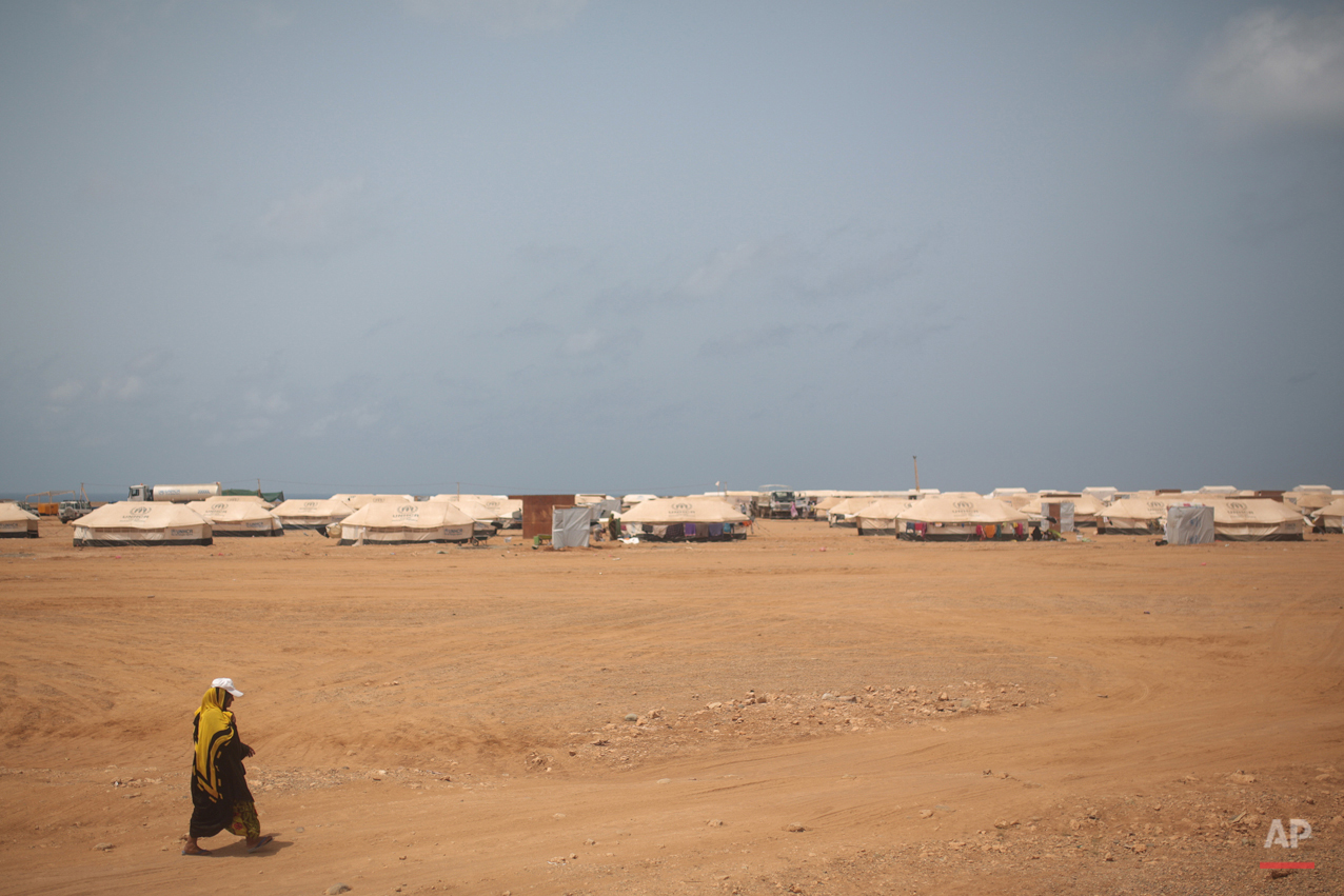 In this Wednesday, May 20, 2015 photo, a Yemeni refugee walks on her way to the Markaze refugee camp where Yemeni refugees are stationed, in Obock, northern Djibouti. Fleeing the war at home, thousands of Yemenis have made it across the Gulf of Aden to find refuge in Djibouti, a sleepy Horn of Africa nation where the United Nations has set up a staging hub for aid for the conflict-torn Arab country. (AP Photo/Mosa'ab Elshamy)