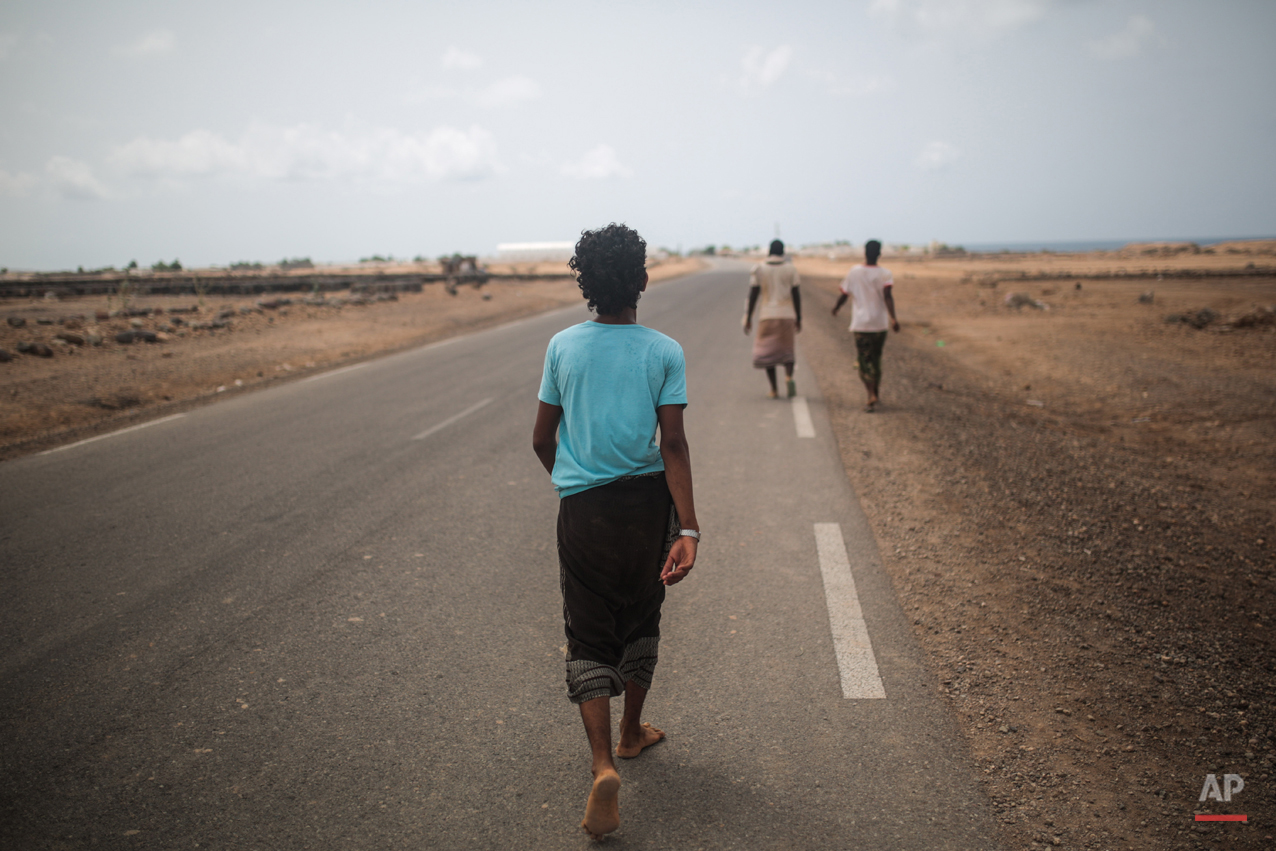In this Wednesday, May 20, 2015 photo, Yemeni refugee trek from their camp to the center of Obock city, northern Djibouti. The UNHCR says a total of 5,000 Yemeni refugees have made it to Djibouti, including 3,000 in the capital, Djibouti city, and 1,000 in Obock, 300 kilometers (187 miles) to the north making it currently the biggest Yemeni refugee population. (AP Photo/Mosa'ab Elshamy)