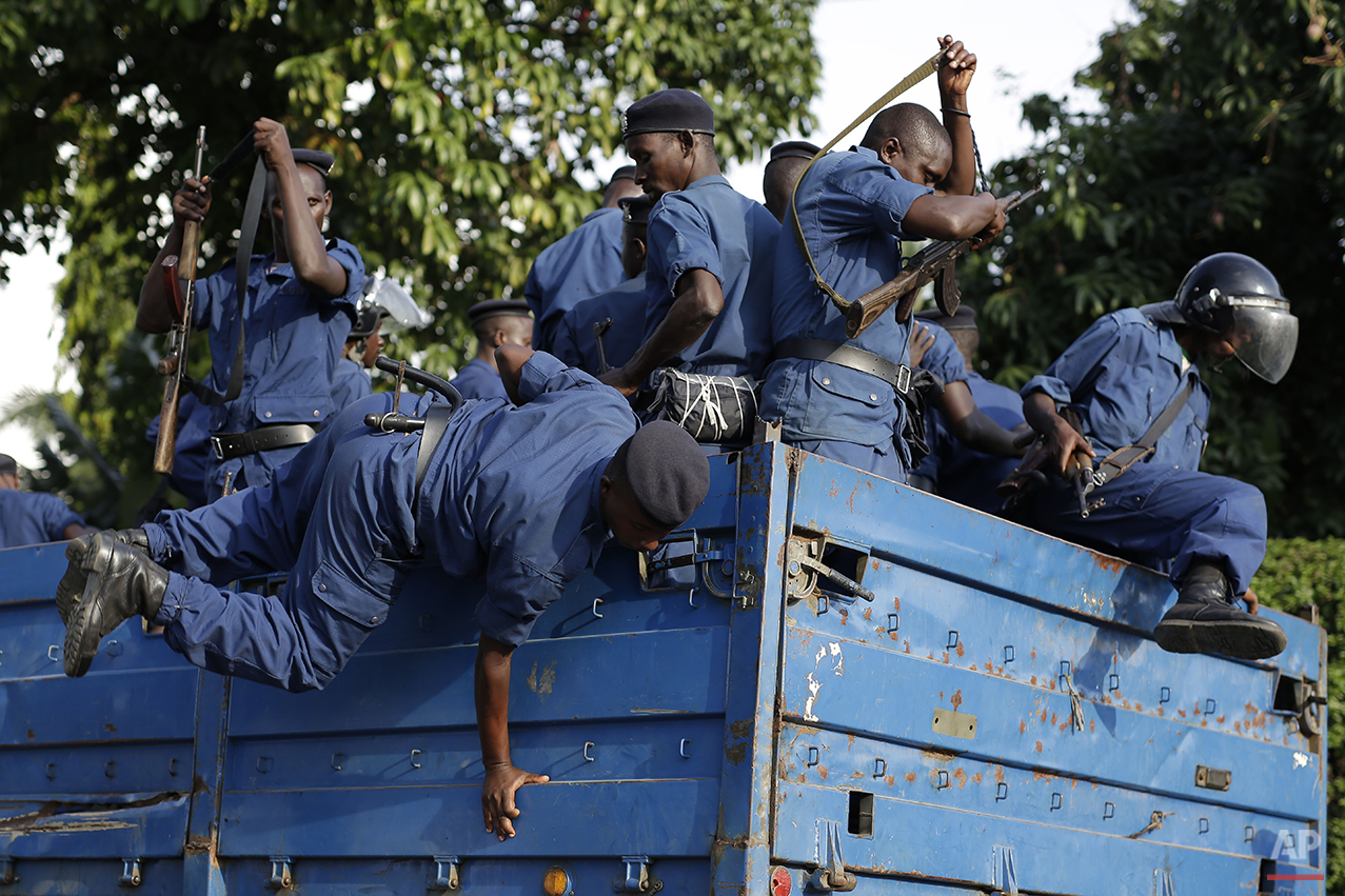 Burundi riot police get off their transport in Bujumbura, Burundi, Wednesday April 29, 2015. Anti-government street demonstrations continued for a fourth day after six people died in protests against the move by President Pierre Nkurunziza to seek a third term.  Presidential elections are scheduled for June 26. (AP Photo/Jerome Delay)