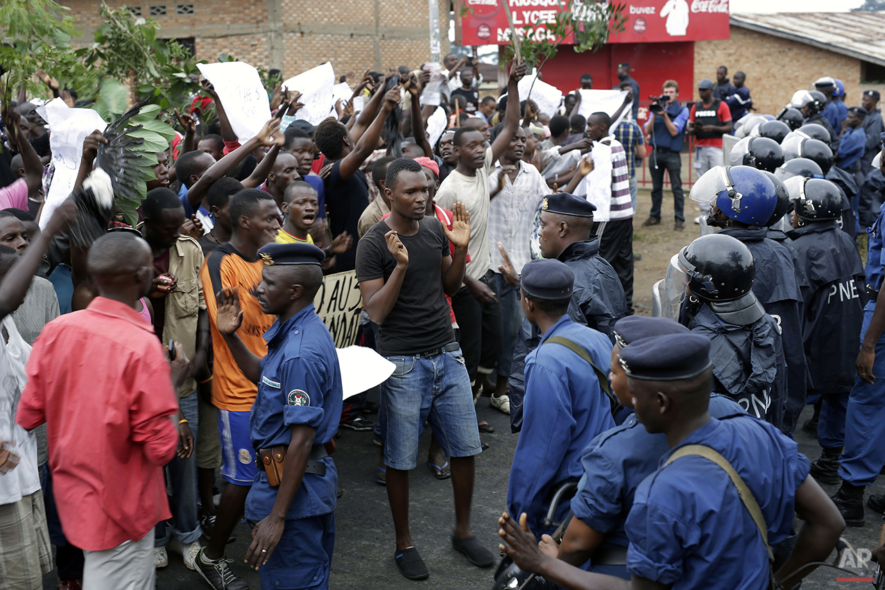 Demonstrators and police face off in Bujumbura, Burundi Thursday, April 30, 2015. Bujumbura has been hit by street protests since Sunday as the security forces confront demonstrators who say a third term for President Pierre Nkurunziza would violate the country's constitution. (AP Photo/Jerome Delay)