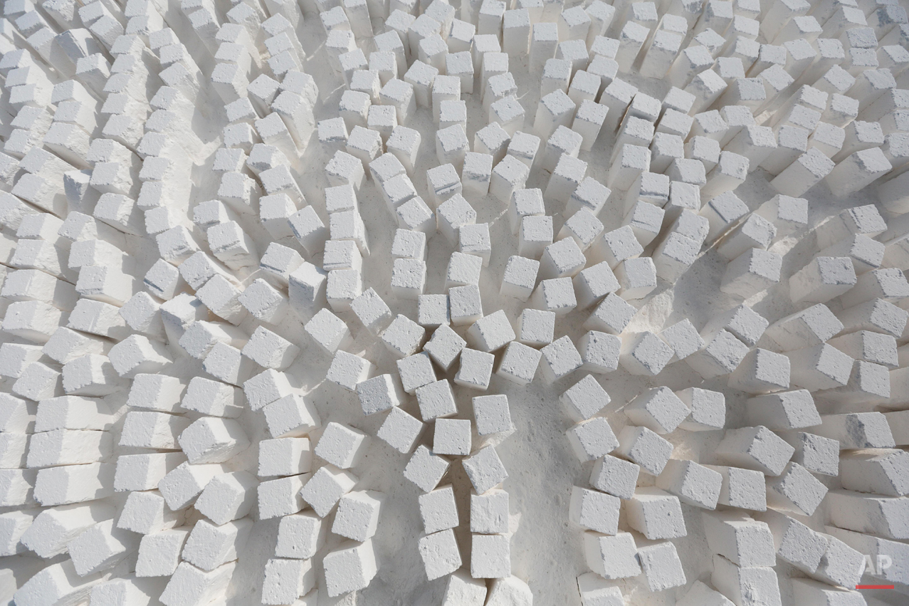 In this Wednesday, March 18, 2015 photo, freshly cut limestone bricks are arranged and ready for transport at a quarry in the desert of Minya, southern Egypt. (AP Photo/Mosa'ab Elshamy)