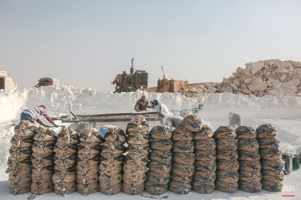 In this Wednesday, March 18, 2015 photo, bags filled with limestone powder are arranged for transport at quarry in the desert of Minya, Egypt. (AP Photo/Mosa'ab Elshamy)