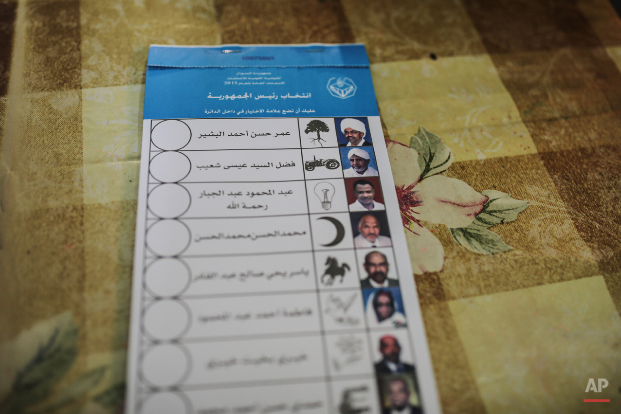 A stack of ballots shows candidates die president including the country's longtime autocrat Omar al-Bashir, top, inside a polling station on the first day of Sudan's presidential and legislative elections, in Khartoum, Sudan, Monday, April 13, 2015. (AP Photo/Mosa'ab Elshamy)