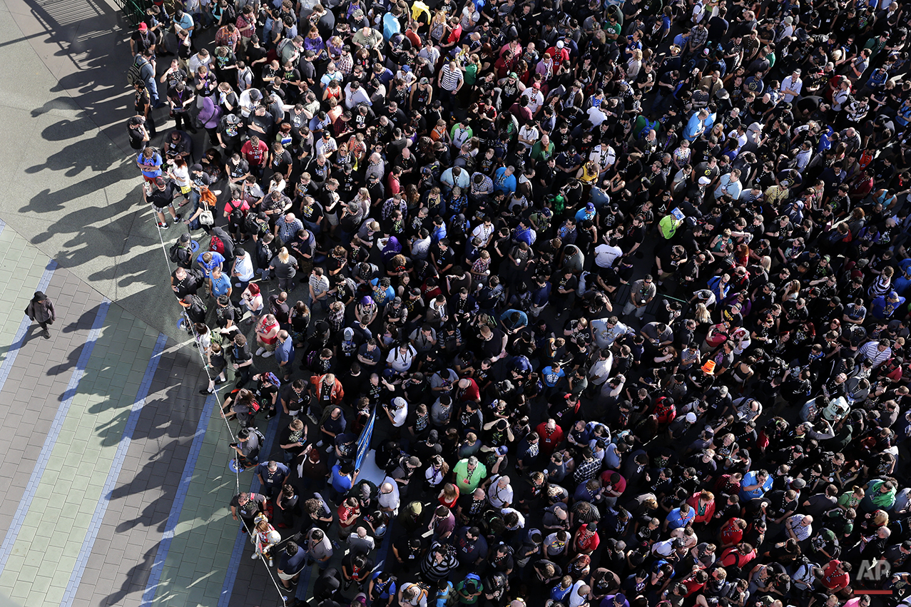 Thousands of people gather outside the Anaheim Convention Center to attend the BlizzCon, the fan-centric celebration of video game publisher Blizzard, Friday, Nov. 7, 2014, in Anaheim, Calif. The annual convention kicked off Friday with more than 25,000 attendees. (AP Photo/Jae C. Hong)