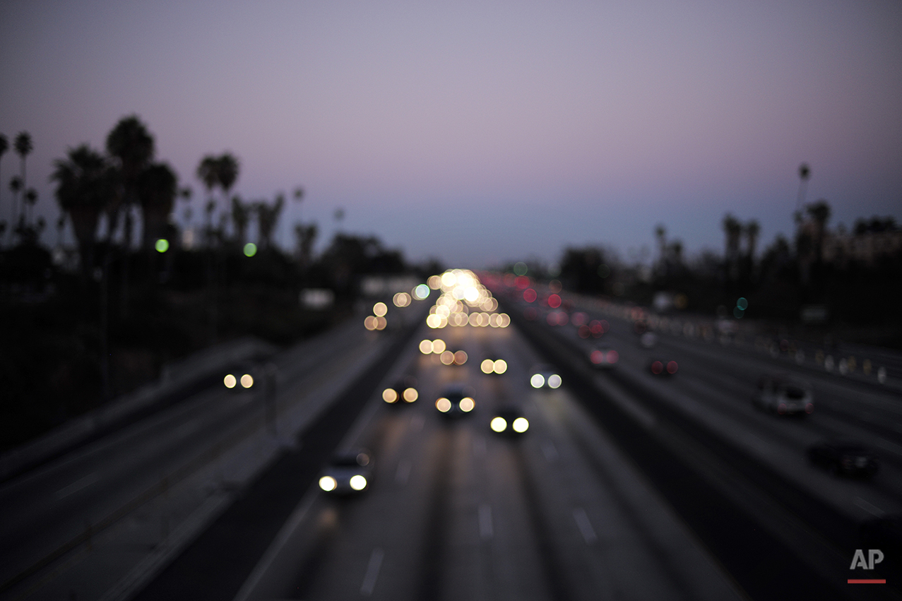 Traffic moves along the 10 freeway on Tuesday, Aug. 26, 2014, in Los Angeles. The I-10 freeway in Los Angeles County is among the most congested freeways in the state according to a report released by the California Department of Transportation. (AP Photo/Jae C. Hong)