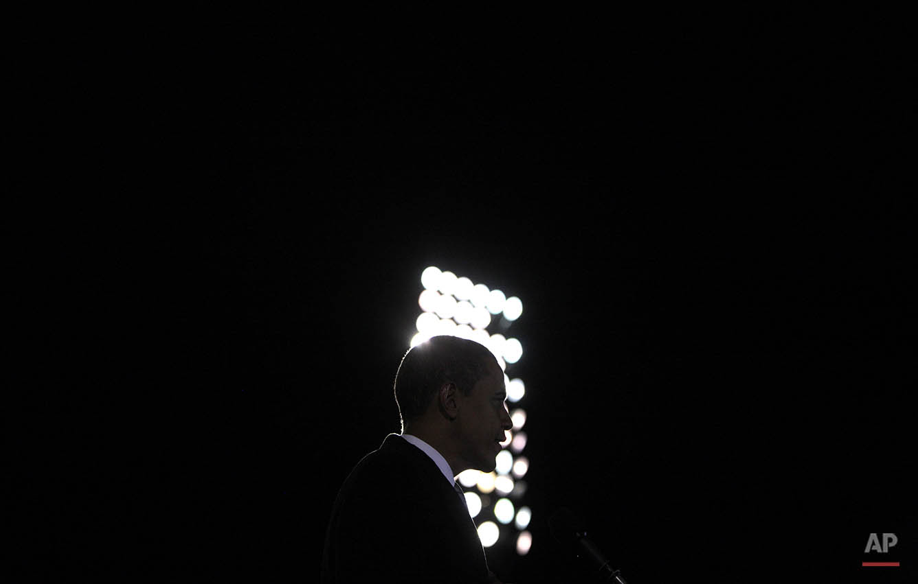 Democratic presidential candidate, Sen. Barack Obama, D-Ill., is silhouetted as he speaks at a rally in Norfolk, Va., Tuesday, Oct. 28, 2008. (AP Photo/Jae C. Hong)