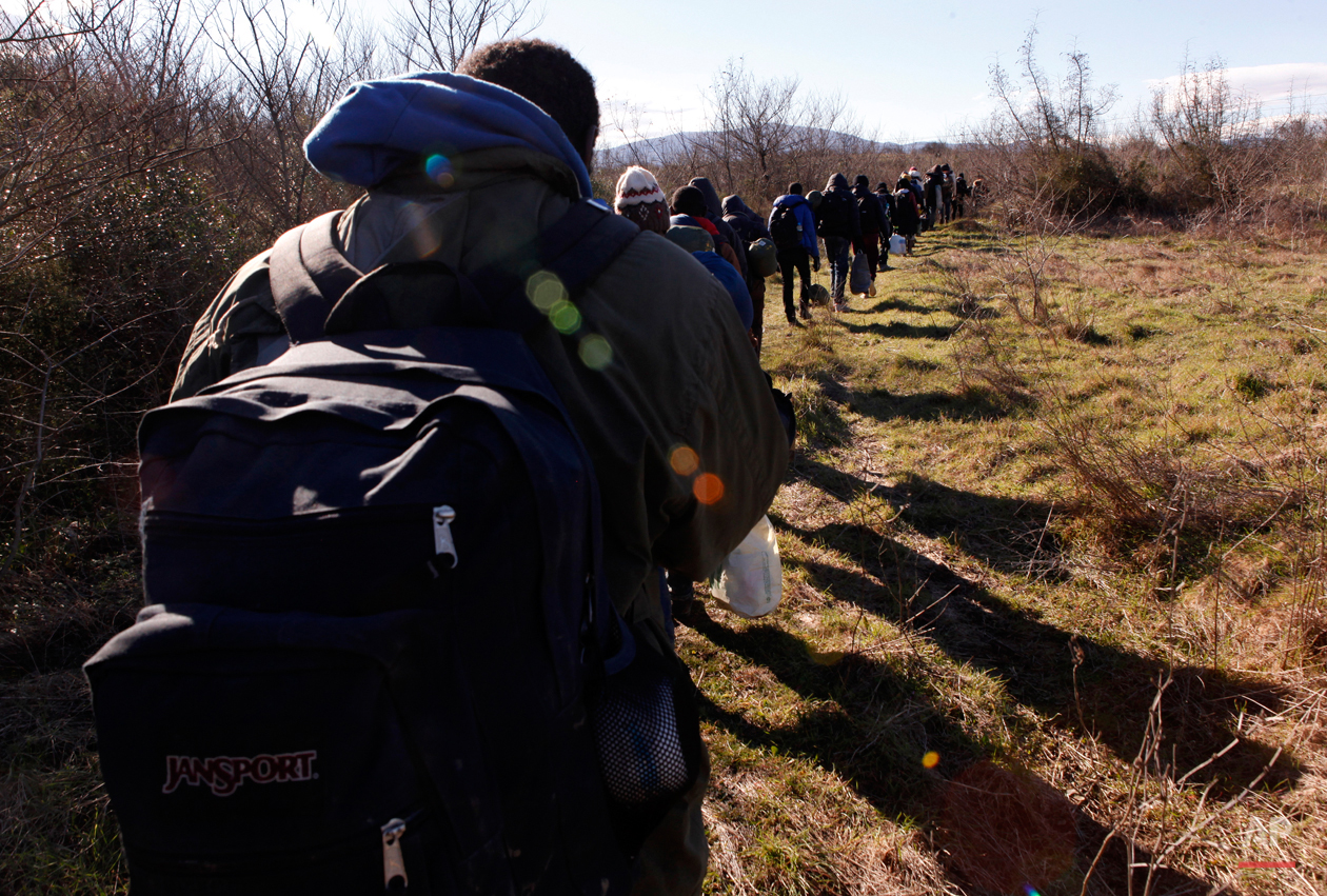 In this Tuesday, March 3, 2015 photo West African migrants walk near the village of Udovo, Macedonia.  The tide of hopeful migrants pours through the vulnerable 'back-door' countries in the hope of entering the 28-nation European Union, and although most people don't make it, the human tide continues to grow, according to Frontex, the EU agency that helps governments police the blocís leaky frontiers. (AP Photo/Dalton Bennett)
