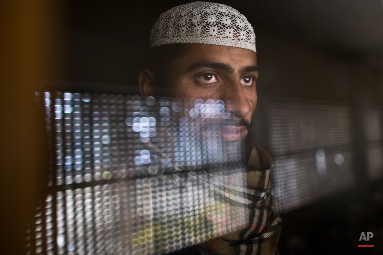 In this Sunday, Feb. 1, 2015 photo, a Pakistani student of a madrassa, or Islamic school, looks out through the window of his classroom at a seminary in Islamabad, Pakistan. Thereís no exact number of madrassas in Pakistan but estimates put the number in the tens of thousands. They provide food, housing and a religious education to students from around the country. Many teach both male and female students. (AP Photo/Muhammed Muheisen)