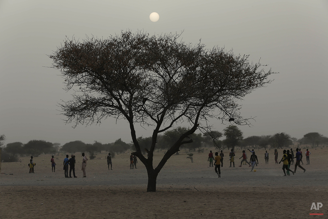 Nigerian boys who fled Boko Haram to Chad play soccer at the Baga Solo refugee camp near the shore of Lake Chad, Wednesday March 4, 2015. The camp, jointly run by the Chadian government and UNHCR, opened mid-January 2015 and hosts over 6000 refugees. Officials say that several thousand had arrived in Chad by the end of 2014 as Boko Haram intensified its attacks in the area. (AP Photo/Jerome Delay)