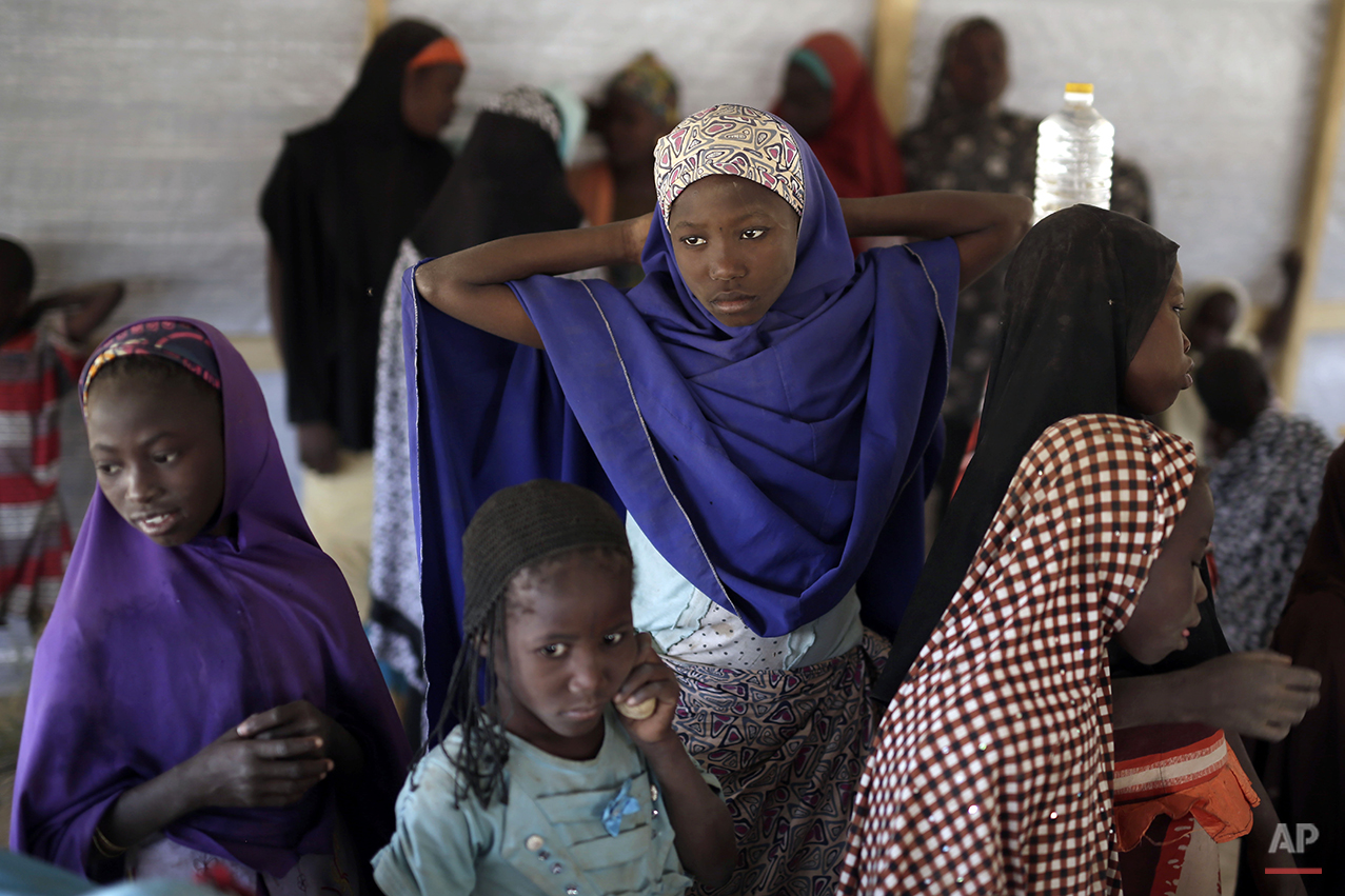 Nigerian girls who fled Boko Haram to Chad gather in a school set up by UNICEF at the Baga Sola refugee camp in Chad, Wednesday March 4, 2015. The camp, jointly run by the Chadian government and UNHCR, opened mid-January 2015 and hosts over 6000 refugees. Officials say that several thousand had arrived in Chad by the end of 2015 as Boko Haram intensified its attacks in the area. After the Baga massacre, another 15,000 came bringing the total now to about 18,000, Chadian authorities believe there are more than 2,000 others still trapped on islands, awaiting transport to the safety of a refugee camp though there are more arriving each day in one of the poorest countries on Earth. (AP Photo/Jerome Delay)