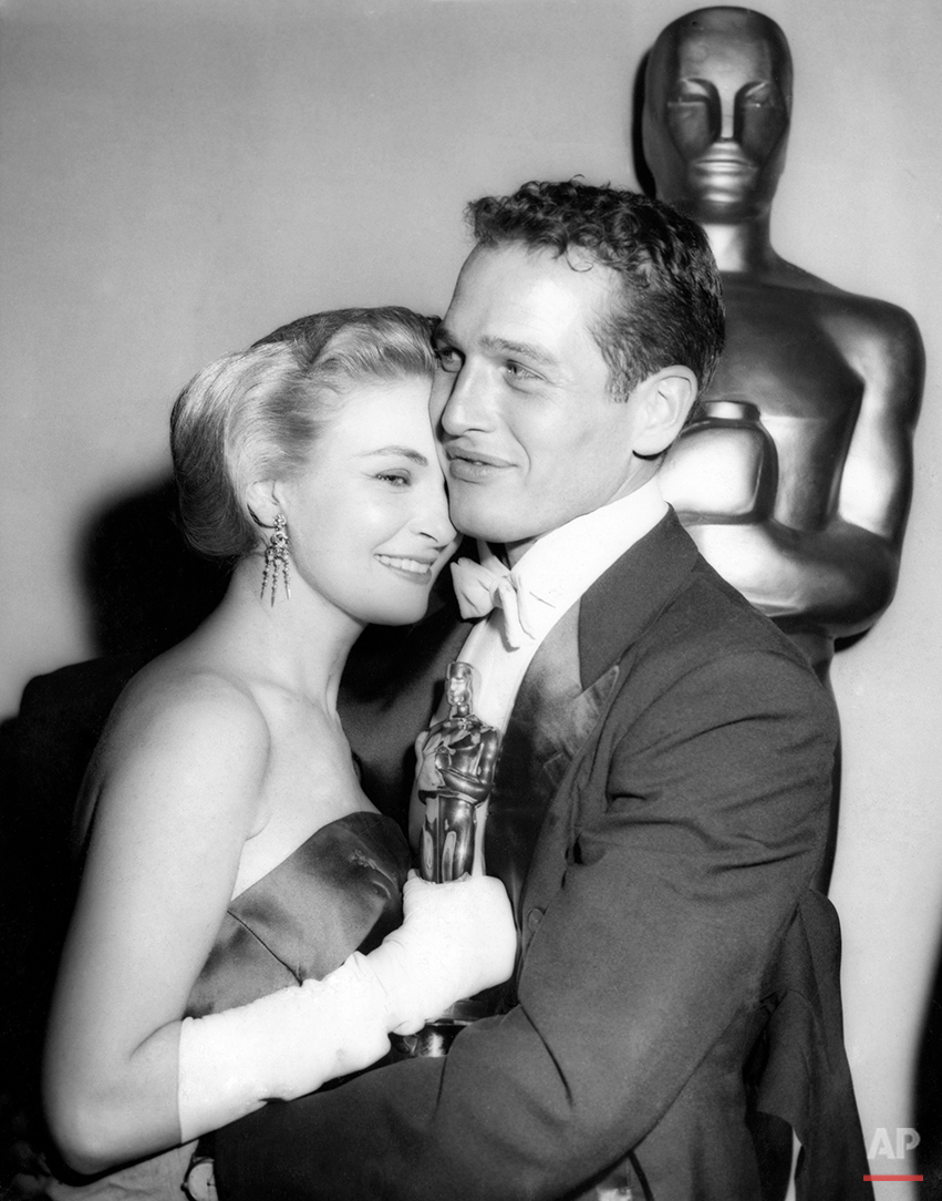 Oscar-winning actress Joanne Woodward is embraced by her husband, actor Paul Newman, backstage at the 30th Academy Award presentations in Hollywood, Calif., March 26, 1958. Woodward won best actress for her role in the motion picture The Three Faces of Eve. (AP Photo)