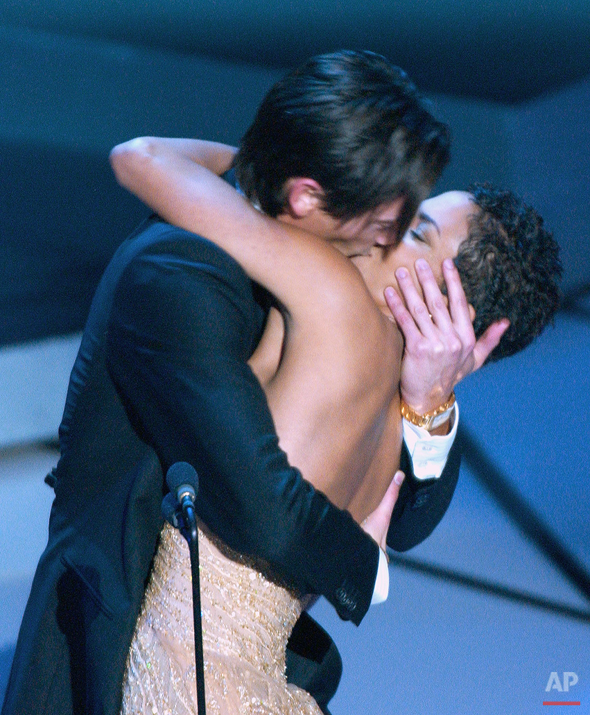 "Actor Adrien Brody suprises presenter Halle Berry with a kiss after he won the Oscar for best actor for his work in ""The Pianist"" at the 75th annual Academy Awards Sunday, March 23, 2003, in Los Angeles. (AP Photo/Kevork Djansezian)"