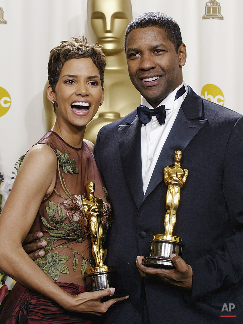 Best actress Halle Berry and best actor Denzel Washington pose for photographers with their Oscar trophies during the 74th annual Academy Awards on Sunday, March 24, 2002 in Los Angeles. (AP Photo/Doug Mills)