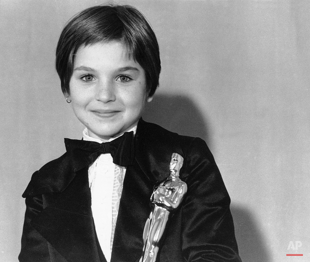 "Tatum O'Neal holds her Oscar statuette at the 46th Annual Academy Awards in Los Angeles, Ca. on April 2, 1974. The 10-year-old won as Best Supporting Actress for her role in the movie ""Paper Moon."" (AP Photo)"