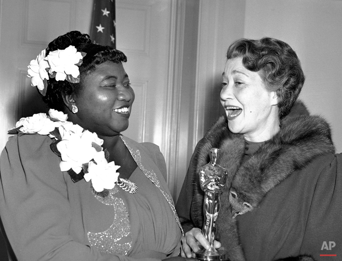 "Hattie McDaniel, left, was given the Motion Picture Academy award for the best performance of an actress in a supporting role in 1939 for her work as ""Mammy"" in the film version of ""Gone With the Wind""  on Feb. 29, 1940 in Los Angeles, Calif.  The presentation of the award was given by actress Fay Bainter, right.  (AP Photo)"