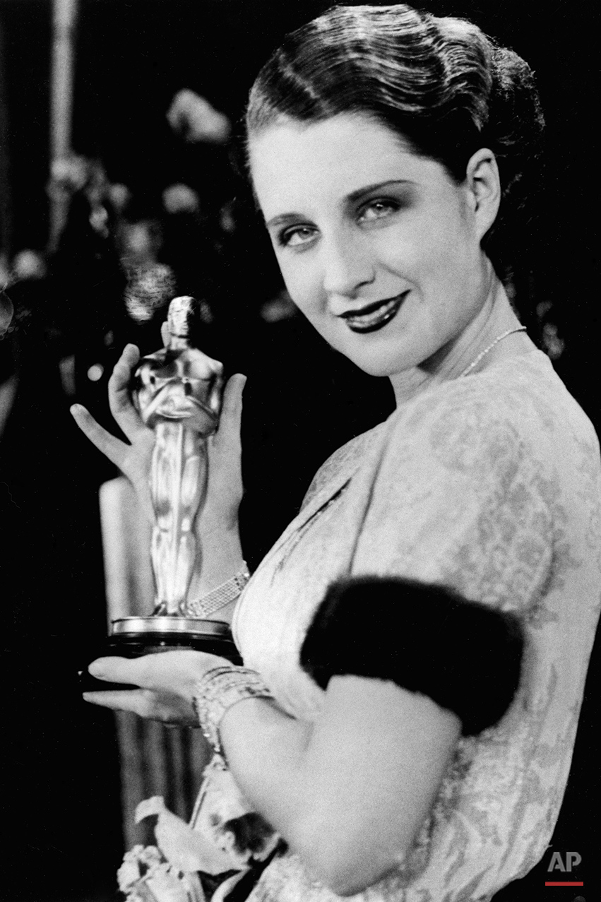 "Actress Norma Shearer poses with her Oscar at the Academy Awards banquet in the Fiesta Room, Ambassador Hotel in Los Angeles, Ca., Nov. 5, 1930.  Shearer won for the best performance given by an actress for the movie ""The Divorce.""  (AP Photo)"