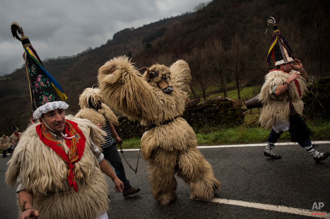 In this photo taken on Tuesday, Jan. 27, 2015 Joaldunaks, some to call them ''Zanpantzar'', take part on the Carnival between of the Pyrenees villages of Ituren and Zubieta, northern Spain. While Rio de Janeiro may boast the worldís most famous carnival, the festive period of masquerades and wild and colorful costumes that precedes the Christian religious season of Lent is also a permanent and popular fixture for celebration in Spain and Portugal, with each country having its own strange and unique way of doing it. The Pyrenees villages of Ituren and Zubieta stage one of Europeís most ancient carnivals _ dating from Roman times _ where residents dress up as figures known as ëJoaldunak,í _ or cowbells _ and parade the streets with sheepskins around the waist and shoulder, conical caps and cowbells on their back. (AP Photo/Alvaro Barrientos)