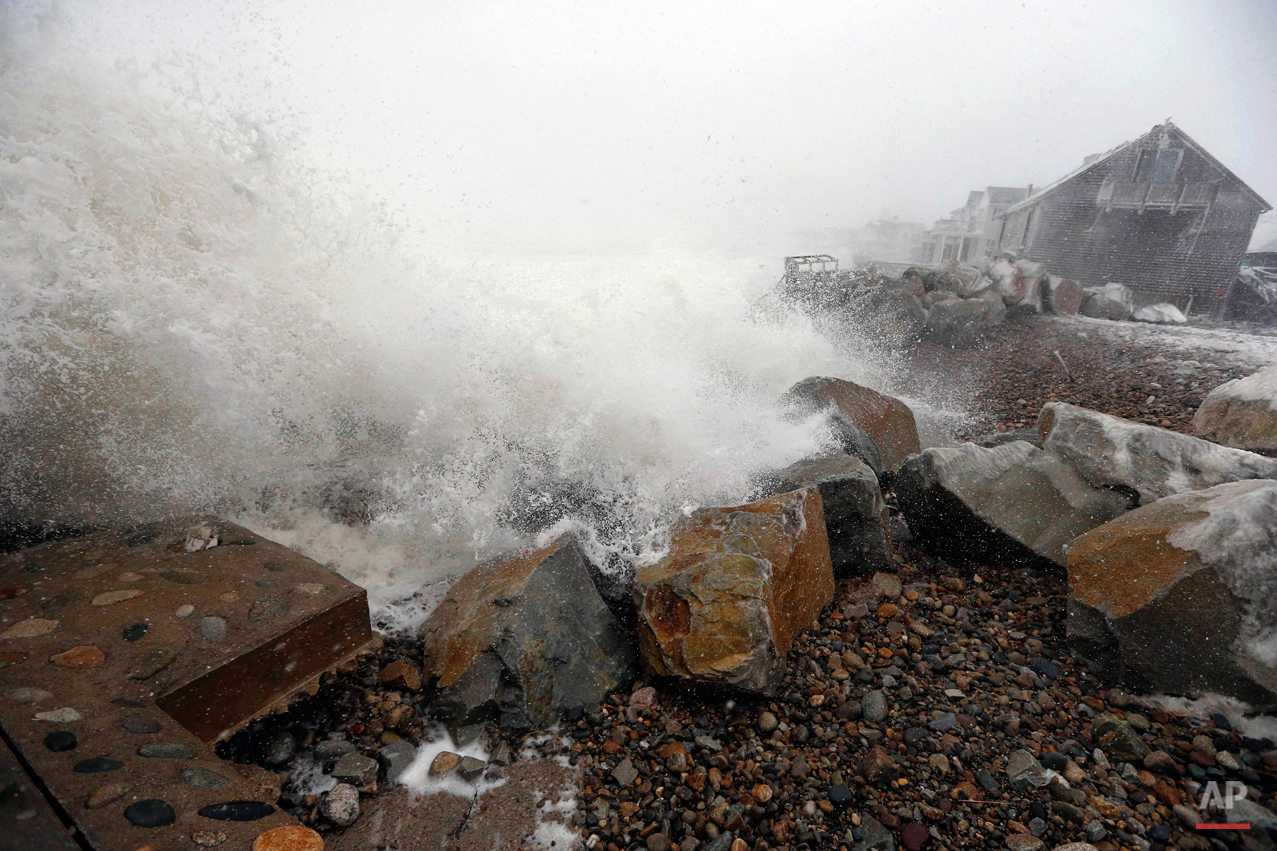 Waves breach a damaged sea wall during a winter storm in Marshfield, Mass., Tuesday, Jan. 27, 2015. A blizzard with 70 mph winds slammed Boston and other parts of New England. (AP Photo/Michael Dwyer)