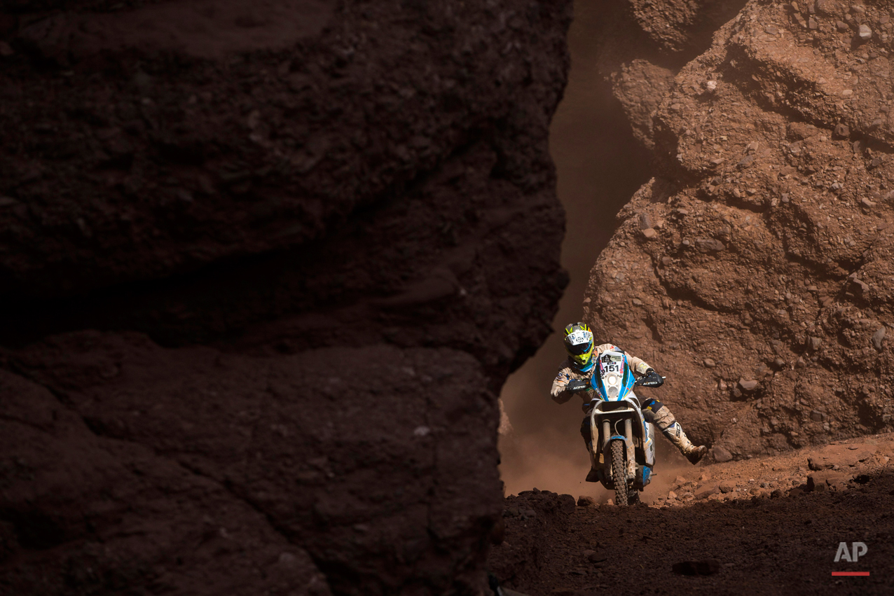 KTM rider Milan Engel of Czech Republic races through the Canyons during the eleventh stage of the Dakar Rally 2015 between the cities of Salta and Termas de Rio Hondo, Argentina, Thursday, Jan. 15, 2015. The race returned to Argentina after passing through Bolivia and Chile and will finish on Jan. 17 in Buenos Aires. (AP Photo/Felipe Dana)