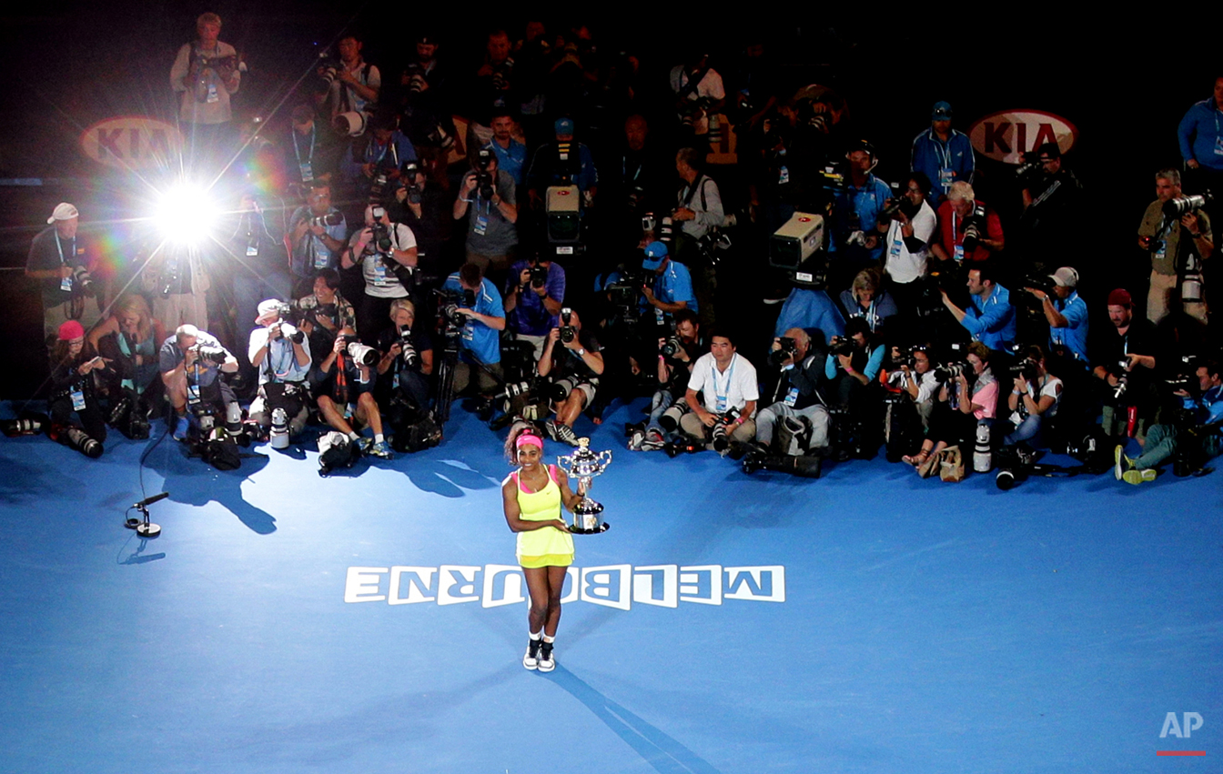 Serena Williams of the U.S. poses the trophy after defeating Maria Sharapova of Russia in the women's singles final at the Australian Open tennis championship in Melbourne, Australia, Saturday, Jan. 31, 2015. (AP Photo/Rob Griffith)