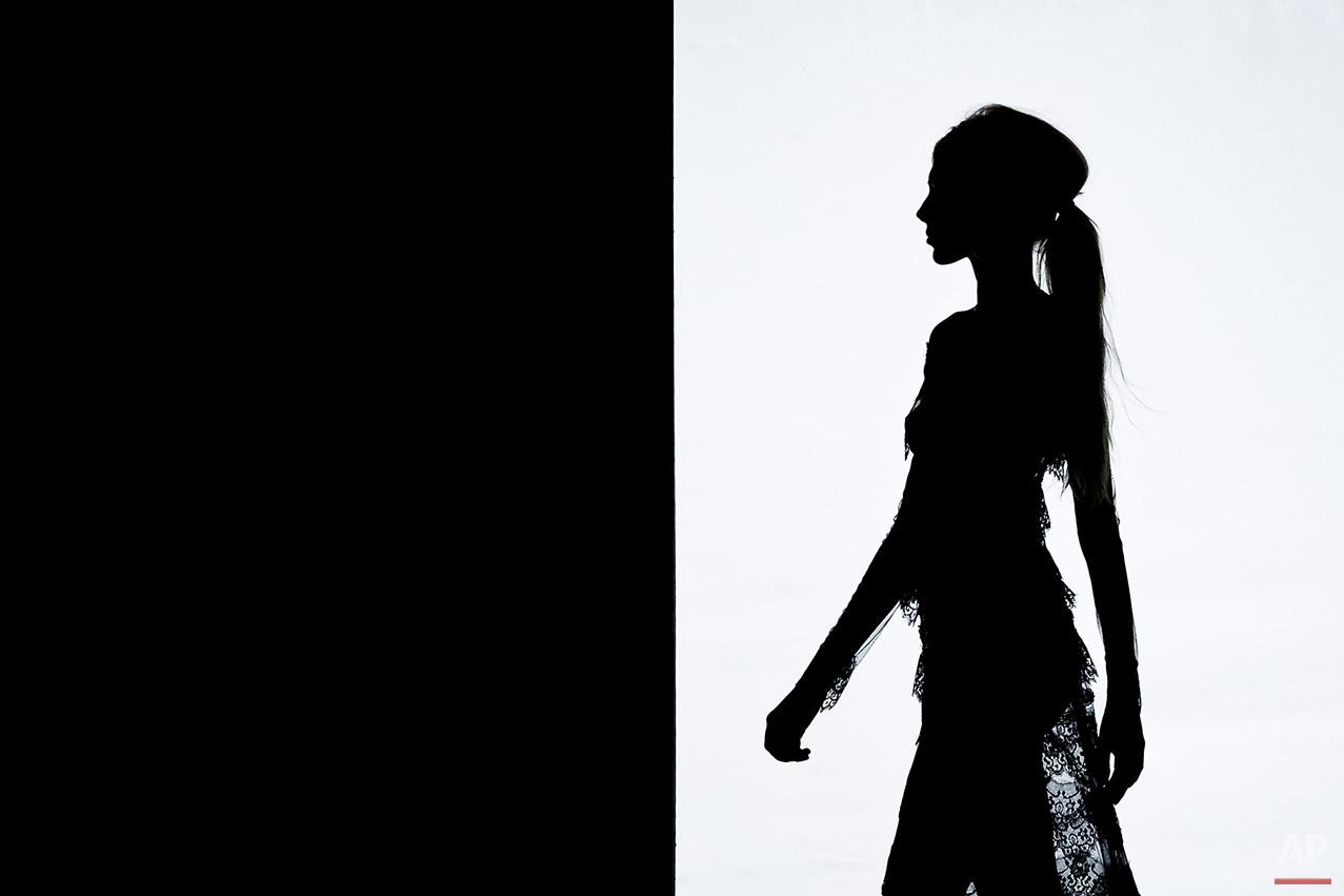 A model displays an Autumn/Winter design by Juana Martin at Madrid's Fashion Week  in Madrid, Spain, Sunday, Feb. 8, 2015 . (AP Photo/Daniel Ochoa de Olza)
