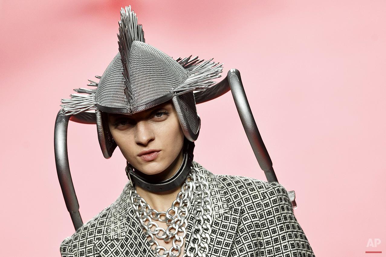 A model displays an Autumn/Winter design by Francis Montesinos at Madrid's Fashion Week  in Madrid, Spain, Sunday, Feb. 8, 2015 . (AP Photo/Daniel Ochoa de Olza)