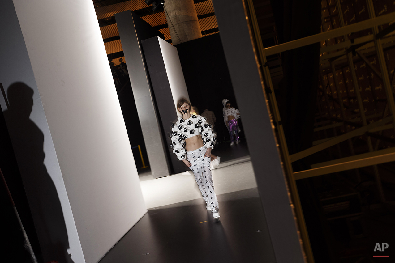A models walks backstage after displaying an Autumn/Winter design by Maria Magdalena during the EGO for young designers at Madrid's Fashion Week  in Madrid, Spain, Wednesday, Feb. 11, 2015 . (AP Photo/Daniel Ochoa de Olza)