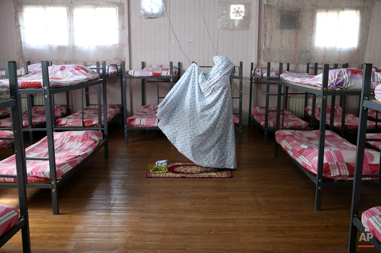 In this Monday, Feb. 2, 2015 photo, a female drug addict prays at her dorm, in Chitgar treatment camp, in a mountain village northwest of Tehran, Iran. Officials say methamphetamine production and abuse are skyrocketing in the country despite potentially lethal criminal penalties if caught, partly because of Iranís status as the gateway for the regionís top drug exporter, Afghanistan _ and partly because Iranian dealers are profiting so handsomely from sales to overstressed students and exhausted double-jobbers. (AP Photo/Ebrahim Noroozi)