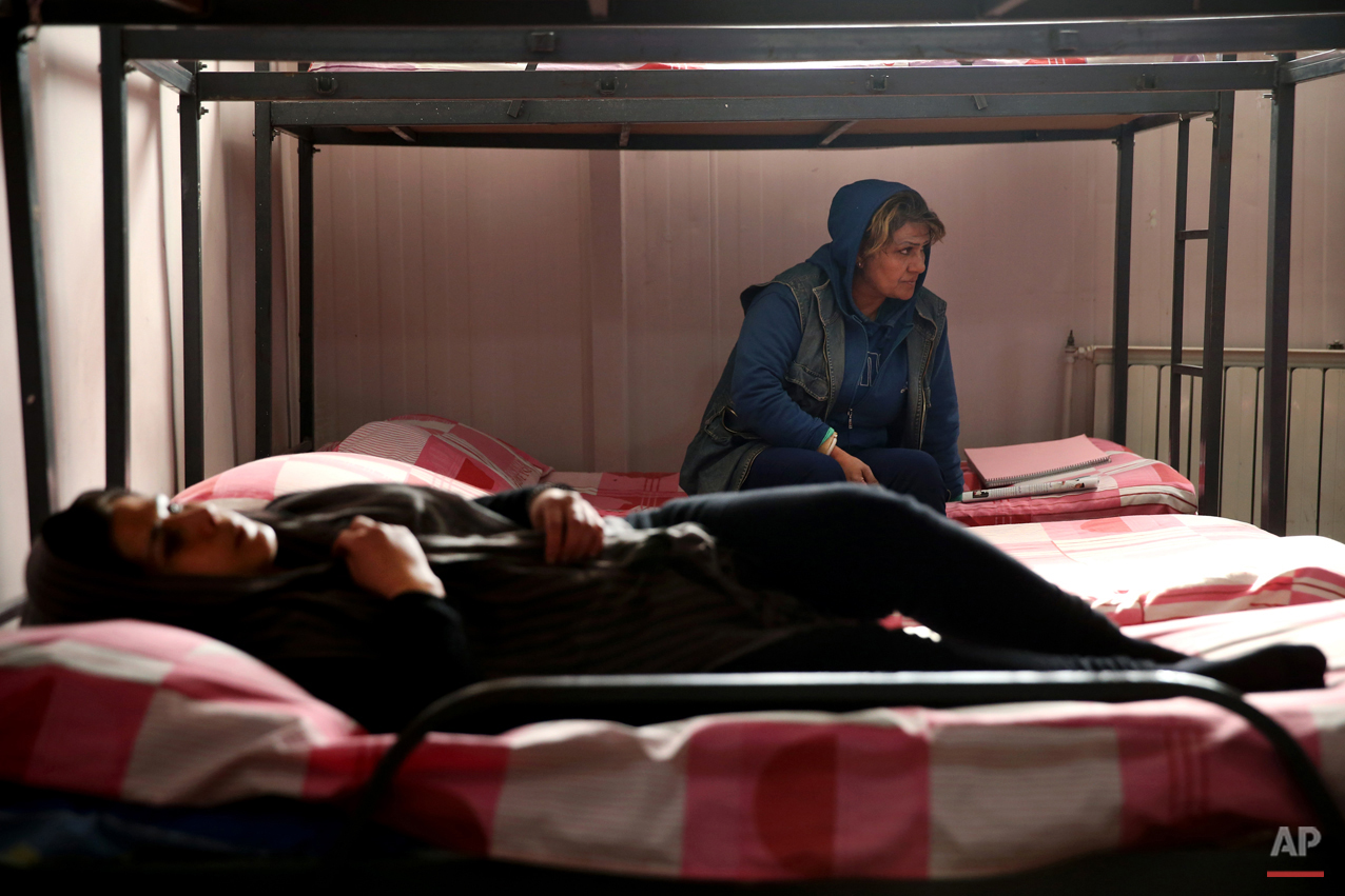 In this Monday, Feb. 2, 2015 photo, female drug addicts rest at their dorm in Chitgar treatment camp, in a mountain village northwest of Tehran, Iran. Anti-narcotics and medical officials say more than 2.2 million of Iran's 80 million citizens already are addicted to illegal drugs, including 1.3 million on registered treatment programs. They say the numbers keep rising annually, even though use of the death penalty against convicted smugglers has increased, too, and now accounts for more than nine of every 10 executions. (AP Photo/Ebrahim Noroozi)