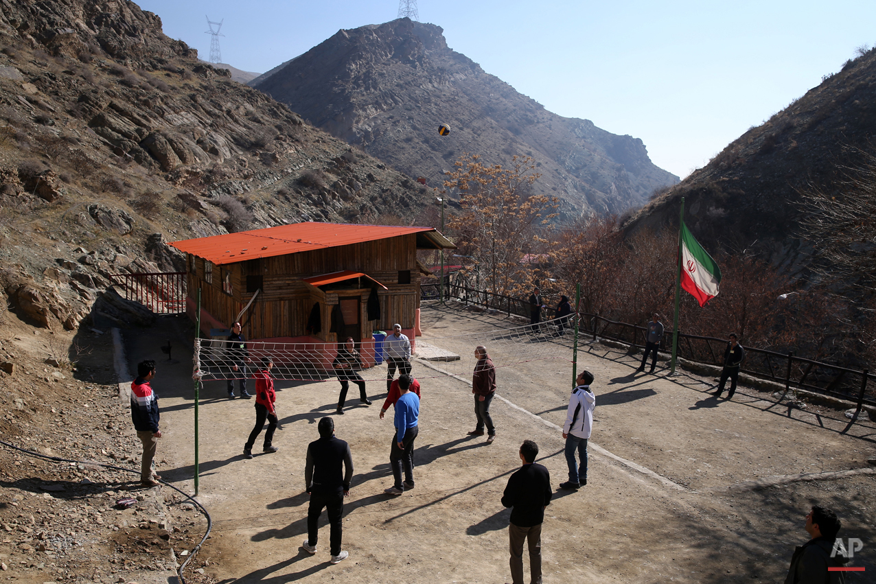 In this Monday, Feb. 2, 2015 photo, drug addicts play volleyball at a treatment camp in Verdij some 15 miles (25 kilometers) northwest of the capital Tehran, Iran. Anti-narcotics and medical officials say more than 2.2 million of Iran's 80 million citizens already are addicted to illegal drugs, including 1.3 million on registered treatment programs. (AP Photo/Ebrahim Noroozi)