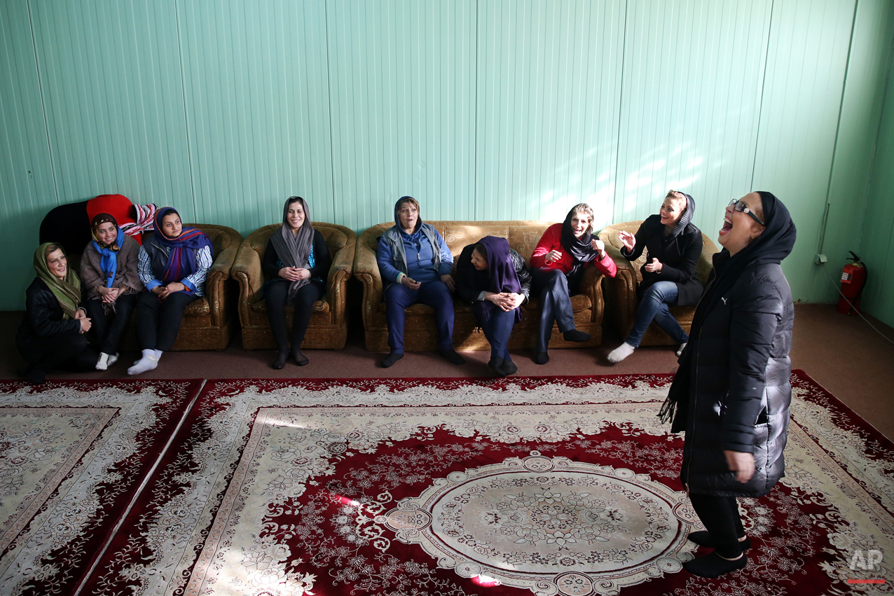 In this Monday, Feb. 2, 2015 photo, female drug addicts play pantomime, at Chitgar treatment camp, in a mountain village northwest of Tehran, Iran. Anti-narcotics and medical officials say more than 2.2 million of Iran's 80 million citizens already are addicted to illegal drugs, including 1.3 million on registered treatment programs. (AP Photo/Ebrahim Noroozi)